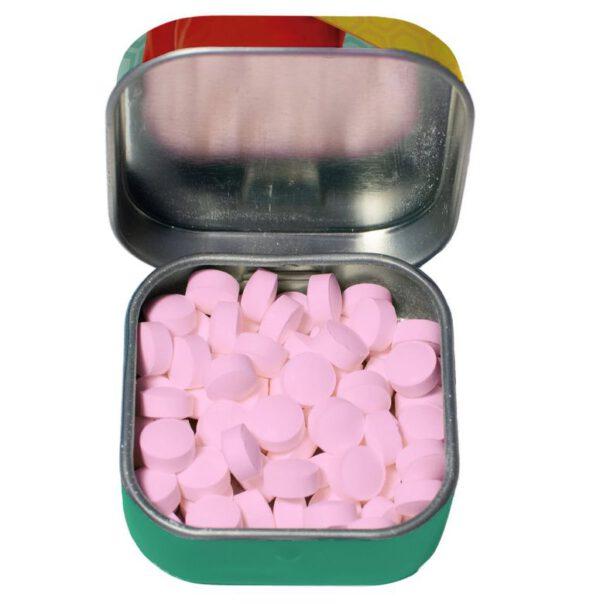 caja de pastillas abierta y pastillas