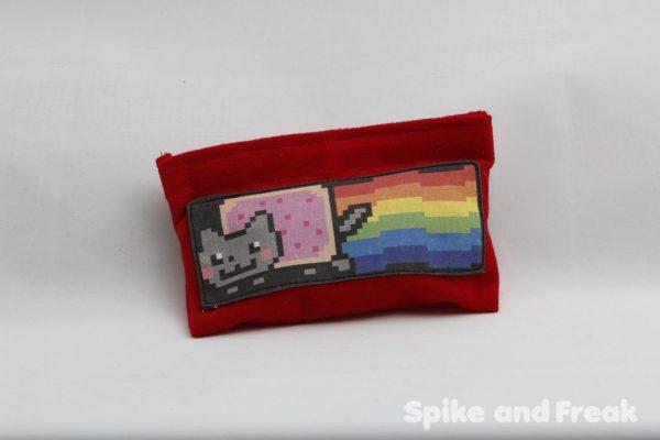 Monedero Nyan cat lleno de dados