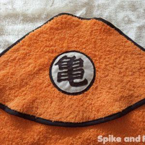 capa toalla Dragon Ball, símbolo Mutenroshi detalle cabeza