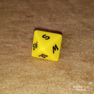 D8 caras puntos cardinales amarillo